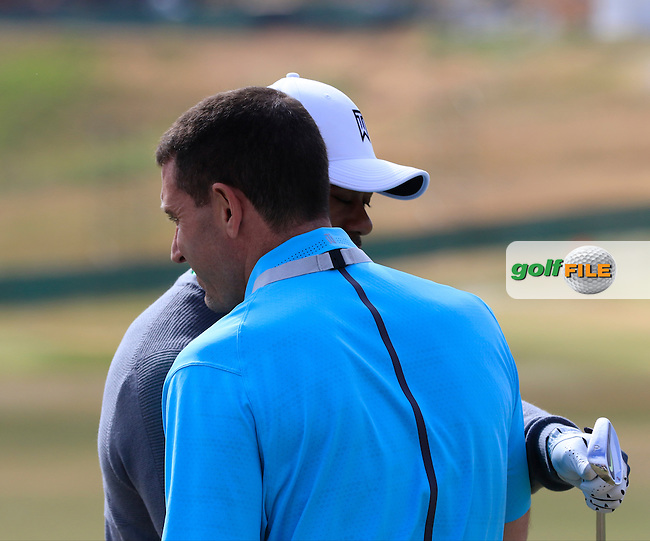 Tiger WOODS (USA) greets manager Mark Steinberg on the range during Tuesday's Practice Day of the 2015 U.S. Open 115th National Championship held at Chambers Bay, Seattle, Washington, USA. 6/16/2015.<br /> Picture &copy; Golffile/Eoin Clarke