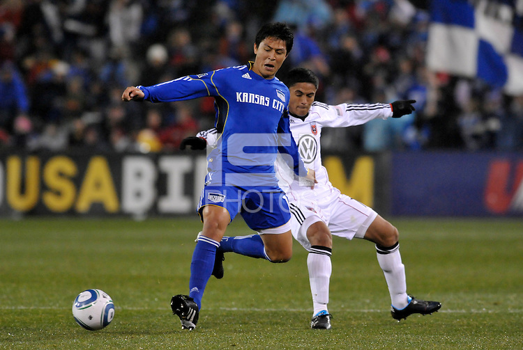 Roger Espinoza (blue), Andy Najar (white)...Kansas City Wizards defeated DC United 4-0 in their season opener, at Community America Ballpark in Kansas City, Kansas.
