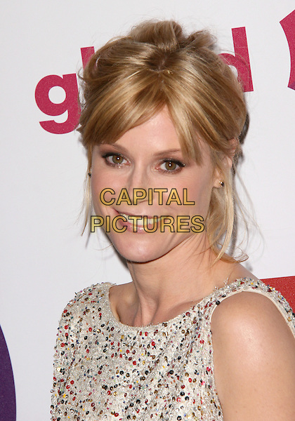 JULIE BOWEN .at The 22nd Annual Glaad Media Awards held at The Westin Bonaventure  in Los Angeles, California, USA, .April 10th 2011..portrait headshot  smiling print  red sequined sequin beaded  white smiling beauty                                                                     .CAP/RKE/DVS.©DVS/RockinExposures/Capital Pictures.