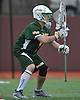 DJ Kellerman #1 Ward Melville goalie gets in position during a non-league varsity boys lacrosse game against host Chaminade High School on Saturday, Apr. 2, 2016. He made a save in the final second of play to preserve a 9-8 win for the Patriots.