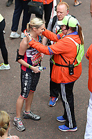 Jenni Falconer<br /> carried away by St John's Ambulance at the finish line on The Mall at the 2017 London Marathon, London. <br /> <br /> <br /> &copy;Ash Knotek  D3254  23/04/2017