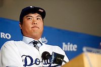 Hyun-Jin Ryu is introduced as the newest member of the Los Angeles Dodgers during a press conference at Dodger Stadium in Los Angeles, California on December 10, 2012. (Larry Goren/Four Seam Images)