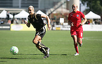 Leslie Osborne (left) controls the ball ahead of Allie Long (9).  Washington Freedom defeated FC Gold Pride 4-3 at Buck Shaw Stadium in Santa Clara, California on April 26, 2009.