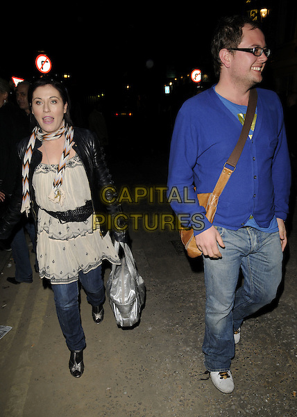 JESSIE WALLACE & ALAN CARR.Spotted walking along Greek Street, Soho, London, England..April 22nd, 2008.full length jeans denim glasses blue cardigan cream dress black scarf brown satchel bag silver black leather jacket .CAP/CAN.©Can Nguyen/Capital Pictures.
