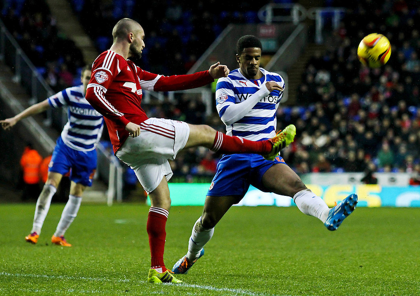 Nottingham Forest's Henri Lansbury clears the ball past Reading's Garath McCleary.<br /> <br /> Photo by James Marsh/CameraSport<br /> <br /> Football - The Football League Sky Bet Championship - Reading v Nottingham Forest - Wednesday 1st january 2014 - Madejski stadium - Reading<br /> <br /> &copy; CameraSport - 43 Linden Ave. Countesthorpe. Leicester. England. LE8 5PG - Tel: +44 (0) 116 277 4147 - admin@camerasport.com - www.camerasport.com