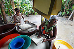 A group of women sift through processed cassava outside of Abidjan, Cote d'Ivoire.