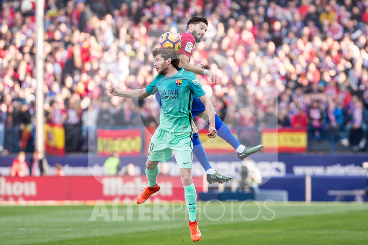 Sergi Roberto of Futbol Club Barcelona competes for the ball with Yannick Ferreira Carrasco of Atletico de Madrid  during the match of Spanish La Liga between Atletico de Madrid and Futbol Club Barcelona at Vicente Calderon Stadium in Madrid, Spain. February 26, 2017. (ALTERPHOTOS)