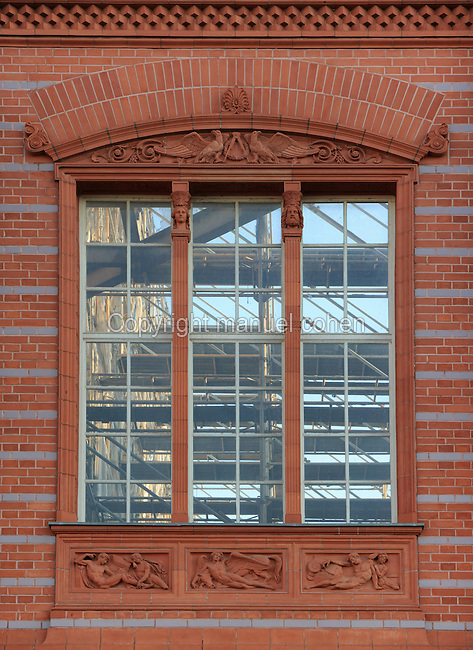 Window of the Bauakademie or Building Academy, showing the derelict interior, originally built 1832-36 by Karl Friedrich Schinkel, home to architectural institutions and universities until it was demolished in 1962 and in 2000 this temporary structure was built resembling the original building, while plans to rebuild it are discussed, Berlin, Germany. Picture by Manuel Cohen