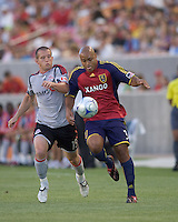 Real Salt Lake midfielder/defender Robbie Russell (3) controls ball for a clear as Toronto FC forward Chad Barrett (19) pressures. Salt Lake Real defeated Toronto FC, 3-0, at Rio Tinto Stadium on June 27, 2009.