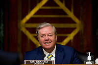 United States Senator Lindsey Graham (Republican of South  Carolina), Chairman, US Senate Judiciary Committee, smiles during a US Senate Judiciary Committee hearing on Capitol Hill in Washington, Tuesday, June 9, 2020, to examine COVID-19 fraud, focusing on law enforcement's response to those exploiting the pandemic. <br /> Credit: Andrew Harnik / Pool via CNP/AdMedia