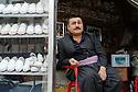 Iraq 2011<br />A traditional shoe retailer in Erbil<br />Irak 2011<br />Un marchand de chaussures kurdes a Erbil
