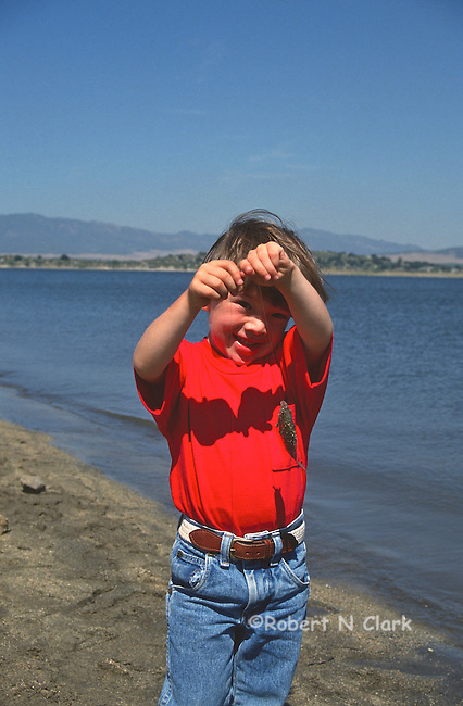 Young fisherman with first bluegill