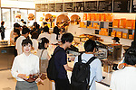 Staff of the new pastry shop ''Dominique Ansel Bakery'' take orders from the press members during the pre-opening event for the bakery's first Japanese store located in Omotesando Hills on June 17, 2015, Tokyo, Japan. The new brand is known for its Cronuts pastry; a croissant doughnut fusion creation by Chef Dominique Ansel and is already hugely popular in New York. This is the first time that it will open an international branch. Japan has seen a recent boom in international food retailers especially trying to become the latest new trend in Tokyo. The store opens its doors to the public on June 20th and long lines are expected. (Photo by Rodrigo Reyes Marin/AFLO)