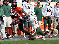 Oct 30, 2010; Charlottesville, VA, USA;   Miami Hurricanes defensive back JoJo Nicolas (29) tackles Virginia Cavaliers wide receiver Kris Burd (18) during the game at Scott Stadium. Virginia won 24-19. Mandatory Credit: Andrew Shurtleff