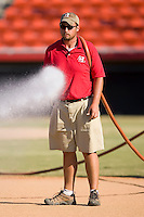 A member of the Hickory Crawdads grounds crew hoses down the infield prior to the start of a South Atlantic League baseball game at L.P. Frans Stadium in Hickory, NC, Wednesday, May 21, 2008.