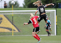 BOYDS, MARYLAND - July 21, 2012:  Ashley Herndon (15) of DC United Women beats Megan Weston (16) of the Virginia Beach Piranhas to a header during a W League Eastern Conference Championship semi final match at Maryland Soccerplex, in Boyds, Maryland on July 21. DC United Women won 3-0.