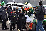 I Love My Duck!--- Children bombard the Duck in a parking lot outside Autzen Stadium..Photo by Jaime Valdez