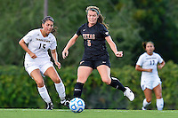 Texas midfielder Julia Dyche (5) and Texas State midfielder Maddie Nichols (15) attempt to control the ball during first period of NCAA soccer game, Sunday, September 21, 2014 in San Marcos, Tex. Texas defeated Texas State 2-0. (Mo Khursheed/TFV Media via AP Images)