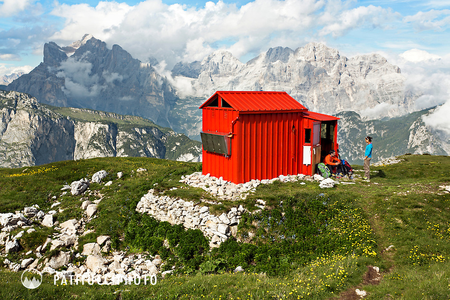 A couple outside the Bedin Bivouac Hut in the Italian Dolomites
