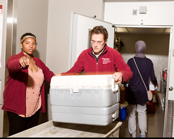 June 30, 2016. Blacksburg, Virginia. <br />  Marc Edwards and Taylor Bradley, who just spent two weeks as the Flint, MI field leader for the Virginia Tech water sampling teams, move new water samples into the lab where they will be stored and tested. <br /> Marc Edwards is a civil engineering/environmental engineer and the Charles P. Lunsford Professor of Civil and Environmental Engineering at Virginia Tech. He is an expert in water quality and corrosion, and his work in Washington DC  and in Flint, Michigan helped to expose high levels of lead contamination in the water supplies of those two cities, triggering investigations into the cause of the pollution.