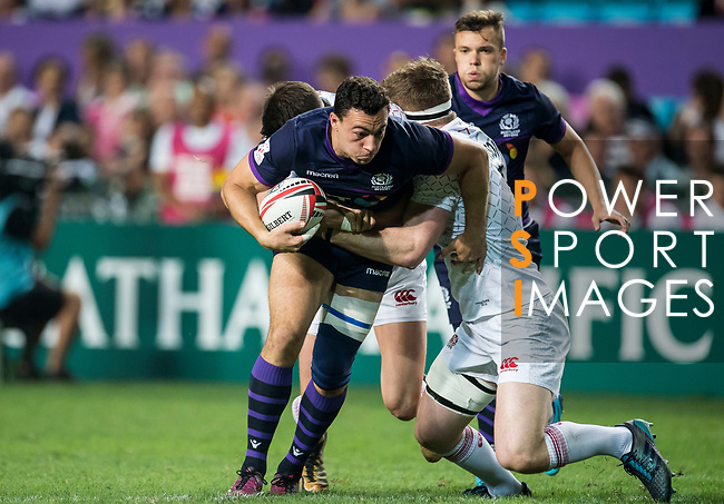 Jamie Farndale of Scotland is tackled by the England defence during their Pool C match between England and Scotland as part of the HSBC Hong Kong Rugby Sevens 2018 on 06 April 2018, in Hong Kong, Hong Kong. Photo by Marcio Rodrigo Machado / Power Sport Images