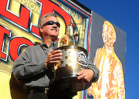 Nov 14, 2010; Pomona, CA, USA; NHRA president Tom Compton holds a championship trophy during the Auto Club Finals at Auto Club Raceway at Pomona. Mandatory Credit: Mark J. Rebilas-