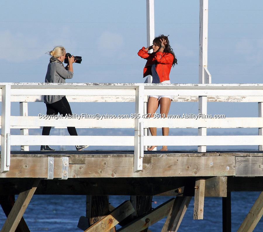 AbilityFilms@yahoo.com<br /> 805 427 3519<br /> www.AbilityFilms.com<br /> <br /> November 9th  2012  Exclusive <br /> <br /> Irina Shayk posing for a photo shoot in Malibu beach California with two male models.