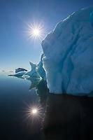 Sun over iceberg in Antarctica