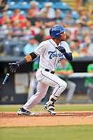 Asheville Tourists Daniel Montano (24) swings at a pitch during a game against the Lexington Legends at McCormick Field on July 3, 2019 in Asheville, North Carolina. The Tourists defeated the Legends 10-6. (Tony Farlow/Four Seam Images)