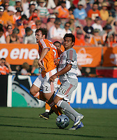 FC Dallas forward Carlos Ruiz (20) attempts to get the ball past Houston Dynamo defender Eddie Robinson (2).  Houston Dynamo defeated FC Dallas 1-0 in an MLS regular season match at Robertson Stadium in Houston, TX on August 19, 2007.