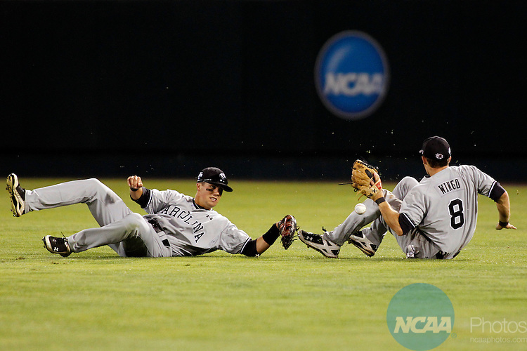 28 JUNE 2010:  Scott Wingo (8) and Whit Merrifield (5) of the University of South Carolina nearly collide trying to make a catch against UCLA during the Division I Men's Baseball Championship held at Rosenblatt Stadium in Omaha, NE.  South Carolina defeated UCLA 7-1 in game one of the best of three series.  Jamie Schwaberow/NCAA Photos