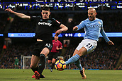 3rd December 2017, Etihad Stadium, Manchester, England; EPL Premier League football, Manchester City versus West Ham United; David Silva of Manchester City  crosses as Declan Rice of West Ham kicks it out for a corner