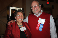 NWA Democrat-Gazette/CARIN SCHOPPMEYER Ruthanne Hill, Arkansas Single Parent Fund executive director, and Jim Crouch, Single Parent Scholarship Fund of Northwest Arkansas visit at Jingle Mingle Dec. 1 at the Barn at the Springs in Springdale.