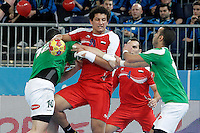 Algeria's Saci Boultif (l) and Omar Benali (r) and Egypt's Ali Zein (c) during 23rd Men's Handball World Championship preliminary round match.January 15,2013. (ALTERPHOTOS/Acero) /NortePhoto