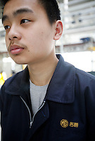 A Chinese worker at the Nanjing MG Automobile plant in Nanjing, China. The Chinese company is now in a position to take on Rover's assets and plan its future. It intended to relocate the engine plant and some car production plant to China but to retain some car production plant in the UK..27 Mar 2007