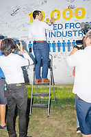 South Bend mayor and Democratic presidential candidate Pete Buttigieg signs a wind turbine blade at the Iowa State Fair in Des Moines, Iowa, on Tues., Aug. 13, 2019.