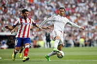 Cristiano Ronaldo of Real Madrid and Raul Garcia of Atletico de Madrid during La Liga match between Real Madrid and Atletico de Madrid at Santiago Bernabeu stadium in Madrid, Spain. September 13, 2014. (ALTERPHOTOS/Caro Marin)