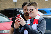 Lincoln City's Bruno Andrade poses for a selfie with fans after arriving at the ground<br /> <br /> Photographer Chris Vaughan/CameraSport<br /> <br /> The EFL Sky Bet League Two - Lincoln City v Macclesfield Town - Saturday 30th March 2019 - Sincil Bank - Lincoln<br /> <br /> World Copyright © 2019 CameraSport. All rights reserved. 43 Linden Ave. Countesthorpe. Leicester. England. LE8 5PG - Tel: +44 (0) 116 277 4147 - admin@camerasport.com - www.camerasport.com