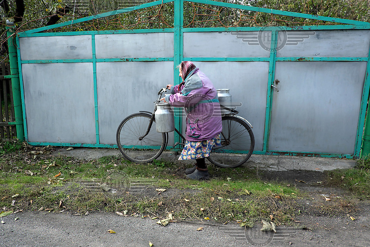 Valya (73) goes in search of water with her bicycle and two metal churns. It has been two years since water flowed from her house taps. Her husband is sick so she has to walk alone to a weekly water distribution supplied by ECHO (European Commission's Humanitarian Aid and Civil Protection department).