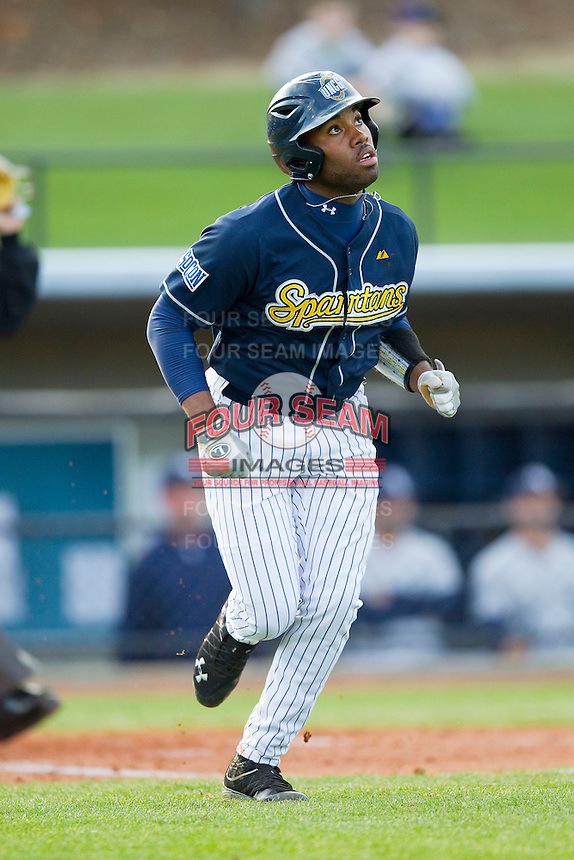 Ray Crawford (1) of the UNCG Spartans hustles down the first base line against the Georgia Southern Eagles at UNCG Baseball Stadium on March 29, 2013 in Greensboro, North Carolina.  The Spartans defeated the Eagles 5-4.  (Brian Westerholt/Four Seam Images)