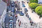 The funeral cortege of Mr Padraig Kennelly as it stops outside the offices of the Kerry's Eye Newspaper on Tuesday.