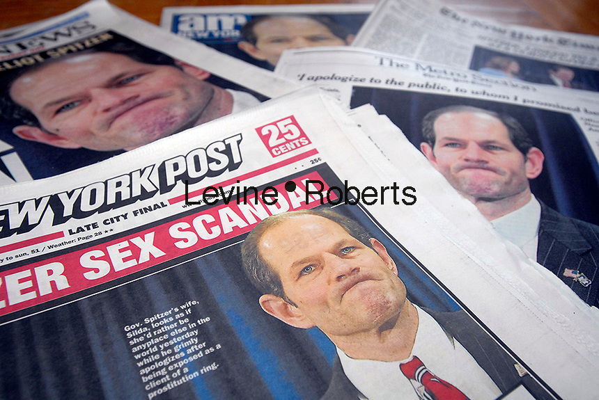 Media coverage in New York City newspapers on March 11, 2008 covering the sex scandal involving NYS Governor Eliot Spitzer. Spitzer allegedly is involved in using prostitutes. (© Richard B. Levine)