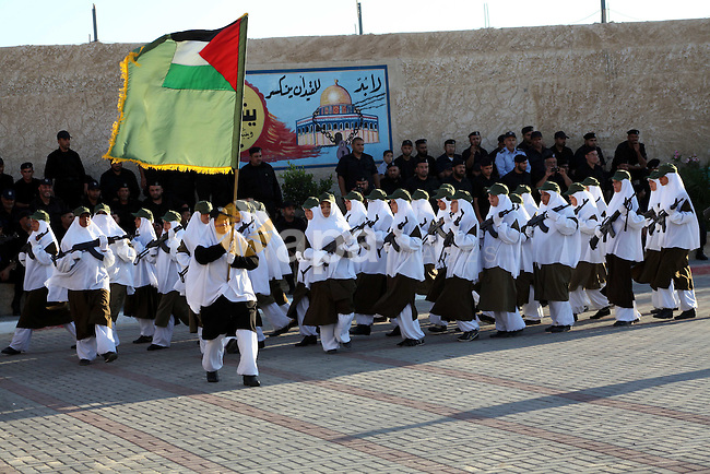 Female Hamas's police officers march during a ceremony in Gaza City on July 05, 2012. Hamas has governed the Gaza Strip since June 2007, after it won a majority of seats in the Palestinian Parliament in the January 2006 Palestinian parliamentary elections, and then defeated the Fatah political organization in a series of clashes. Photo by Ashraf Amra