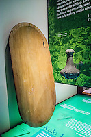 A poi pounder and poi pounding board used to pound taro or kalo, Bishop Museum, Honolulu, O'ahu.