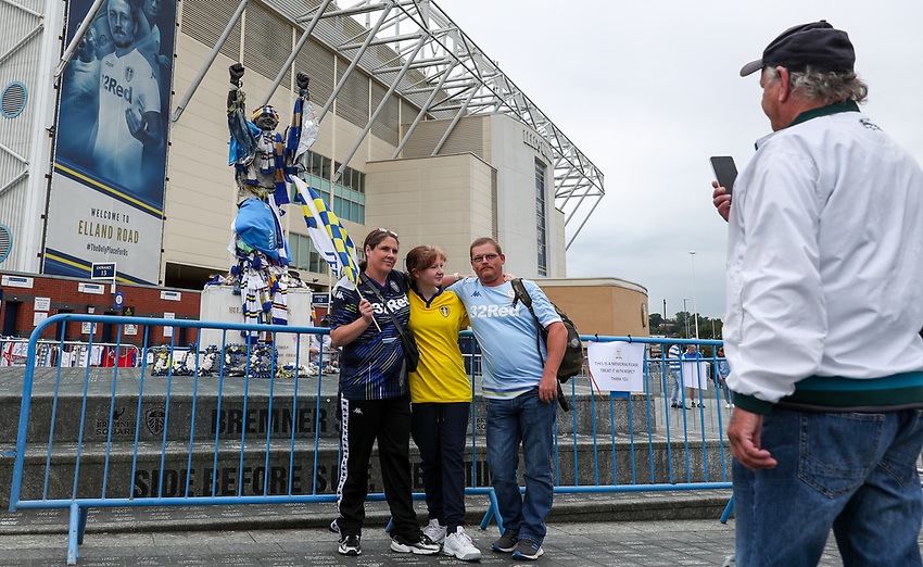 Leeds United fans pose for pictures outside Elland Road<br /> <br /> Photographer Alex Dodd/CameraSport<br /> <br /> The EFL Sky Bet Championship - Leeds United v Charlton Athletic - Wednesday July 22nd 2020 - Elland Road - Leeds <br /> <br /> World Copyright © 2020 CameraSport. All rights reserved. 43 Linden Ave. Countesthorpe. Leicester. England. LE8 5PG - Tel: +44 (0) 116 277 4147 - admin@camerasport.com - www.camerasport.com