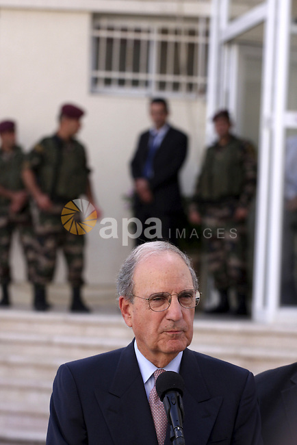 U.S. Middle East envoy George Mitchell and chief Palestinian negotiator Saeb Erekat speak  after Mitchell's meeting with President Mahmoud Abbas in the West Bank city of Ramallah,in the West Bank city of Ramallah on September 30, 2010. Mitchell is in the area trying to rewnew direct peace talks between Israel and the Palestinians since the Israeli 10-month building moratorium on Jewish settlements expired. Netanyahu has not yet said the freeze is officially over nor has he said it continues in some form, as the Palestinians say they will wait for a decision from the Arab League meeting next week to respond to the freeze expiring on 26 September. Photo by Eyad Jadallah