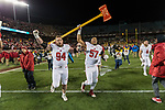 Wisconsin Badgers defensive linemen Conor Sheehy (94) and Alec James (57) celebrate with the Paul Bunyan Axe after an NCAA College Big Ten Conference football game against the Minnesota Golden Gophers Saturday, November 25, 2017, in Minneapolis, Minnesota. The Badgers won 31-0. (Photo by David Stluka)