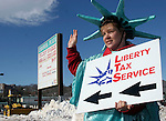 WATERBURY, CT-03 February 2005-020305TK04 Stacey Sembrowich promotes Liberty Tax Service in the Colonial Plaza on Thomaston Avenue in Waterbury.    Tom Kabelka staff photo (Stacey Sembrowich, Liberty Tax Service)CQ