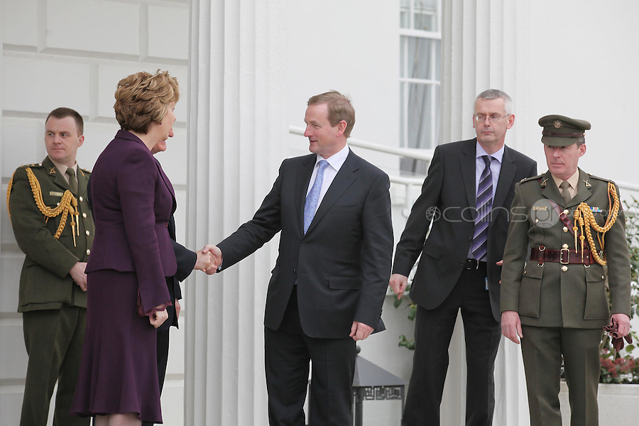 9/3/2011.Taoiseach Enda Kenny bids farewell to President Mary McAleese and her husband Martin as he leaves Áras an Uachtaráin after receiving his seal of office. Picture James Horan/Collins
