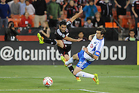 Washington D.C. - May 17, 2014: Fabian Espindola (9) of D.C. United goes against Jeb Brovsky (5) of Montreal Impact.  D.C. United tied the Montreal Impact 1-1 during a Major League Soccer match for the 2014 season at RFK Stadium.